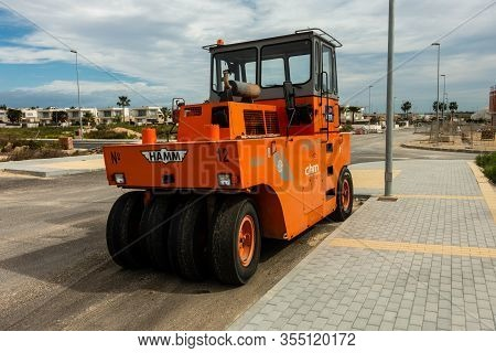 Torrevieja, Valenciana, Spain - Mar 01 2020 : Hamm Heavy Weight Road Laying Vehicle Parked In Spanis