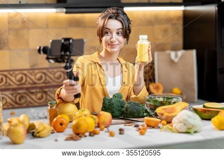 Young And Cheerful Woman Vlogging On Mobile Phone About Healthy Food And Cooking. Concept Of Healthy