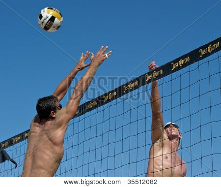 HERMOSA BEACH, CA - JULY 21: Danko Iordanov and Sean Scott compete in the Jose Cuervo Pro Beach Volleyball tournament in Hermosa Beach, CA on July 21, 2012.