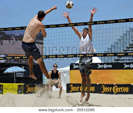 HERMOSA BEACH, CA - JULY 21: Brad Keenan and Andrew Fuller compete in the Jose Cuervo Pro Beach Volleyball tournament in Hermosa Beach, CA on July 21, 2012.