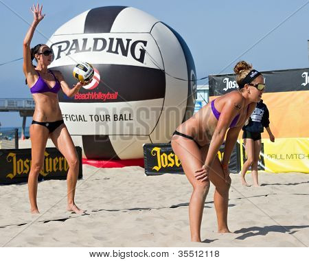 HERMOSA BEACH, CA - JULY 21: Jenny Kropp and Whitney Pavlik compete in the Jose Cuervo Pro Beach Volleyball tournament in Hermosa Beach, CA on July 21, 2012.