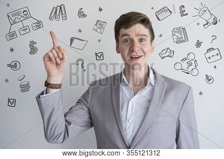 Male Teacher In Gray Jacket With Hand Drawn Business Sketches. Confident Inquisitive Man Showing Ind