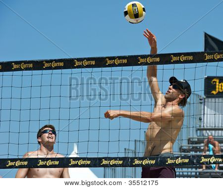 HERMOSA BEACH, CA - JULY 21: Stein Metzger and Mark Williams compete in the Jose Cuervo Pro Beach Volleyball tournament in Hermosa Beach, CA on July 21, 2012.