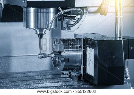 The 4 Axis Cnc Milling Machine Cutting The Sample Parts Attach On The Rotary Table With Solid Ball E