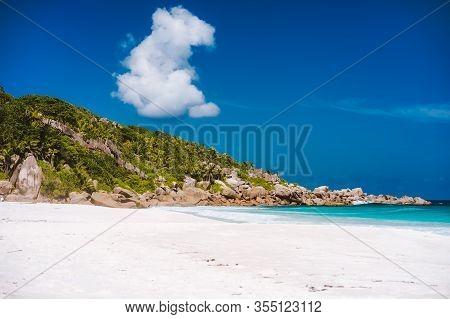 Holiday Vacation On Petite Anse Sandy Tropical Paradise Beach On La Digue Island, Seychelles. Travel