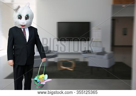Easter Bunny. Easter Bunny in a Business Suit. Easter Bunny with a business office waiting area background. Easter Bunny Man in a suit brings a basket of goodies for Holiday to all at work.