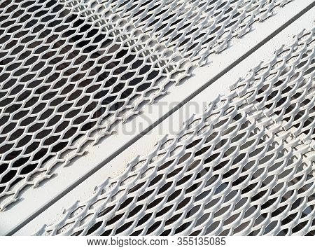 Perforated Metal Sheet Stamping Plates Texture Angled View. Made Through Metal Stamping Sheet Metal