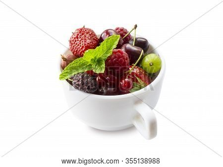 Fruits And Berries In Cup Isolated On White Background. Fruits And Berries With Copy Space For Text.