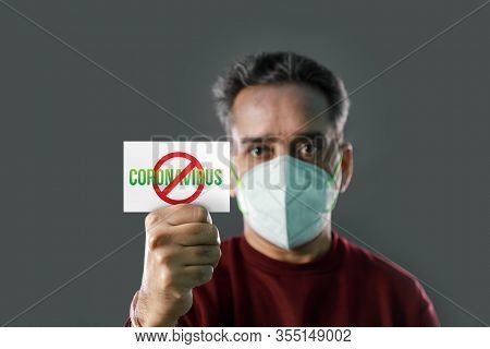 Indian Man With Stop Coronavirus Spread Card In His Hands, Wearing A Mask