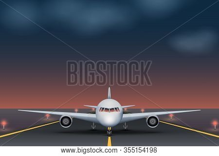 The Plane Takes Off On The Runway At The Airport During The Night. Airplane Standing On Runway Front