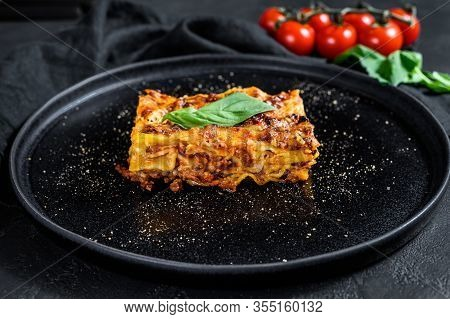 Homemade Italian Lasagna With Tomato Sauce And Beef. Black Background. Top View