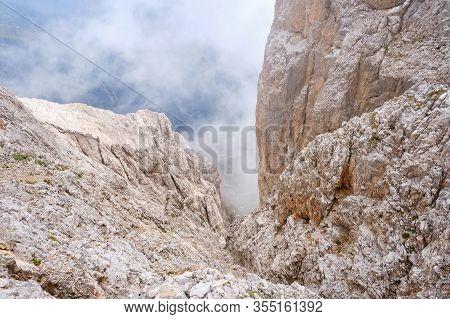 Low Clouds And Fog On A Mountain Couloir, At Via Ferrata Eterna Brigata Cadore Route On Marmolada Gl