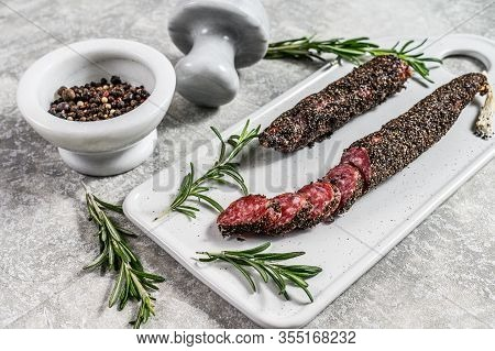 Wurst, Fuet, Sliced Sausage. Pork Sausage. Gray Background. Top View