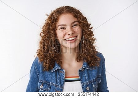 Charming Lucky Queer European Girl Ginger Curly-haired Freckles Pimples Smiling Broadly Without Make