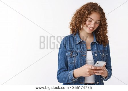 Girl Laughs Smiles Blushing Pleased Read Heartwarming Funny Message Holding Smartphone Look Device D