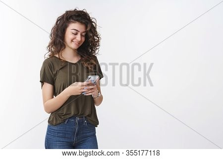 Lovely Armenian Young Happy Cute Woman Curly-haired Holding Smartphone Smiling Gently Laughing Funny