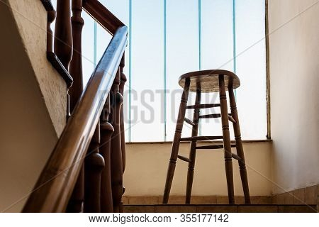 Old Wooden Bar Stool In A Wooden Staircase With Handrailing In An Old House. Interior Decor Of Old S