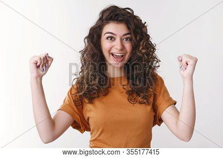 Hooray Excellent. Celebrating Triumphing Happy Excited Armenian Female Student Enjoying Victory Rais