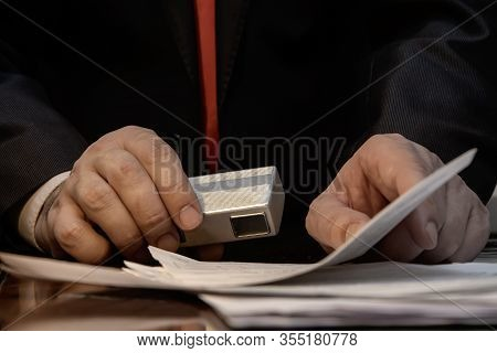 Spy Camera In The Hands Of A Spy , Shooting Secret Documents , Collecting Evidence And Compromising