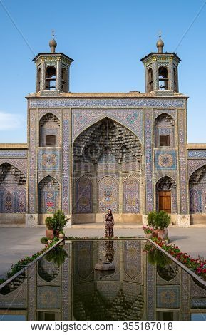 Shiraz, Iran - May 2019: Woman Standing In The Courtyard With Pool Of Nasir Al-mulk Mosque In Shiraz