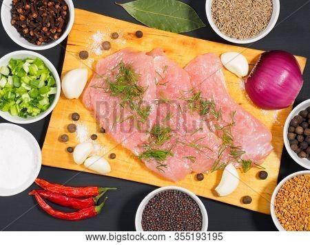 Sliced Pieces Of Meat Turkey Game Filet On A Wooden Cutting Board, Garlic, Cumin (jeera), Salt, Fenn
