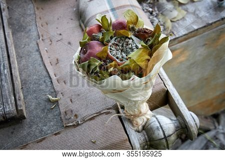 Bunch Of Rotten Fruit And Wilted Flowers And Broken Old Furniture Of A Forgotten And Abandoned House