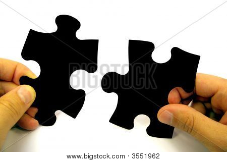 Puzzle Pieces In Hands
