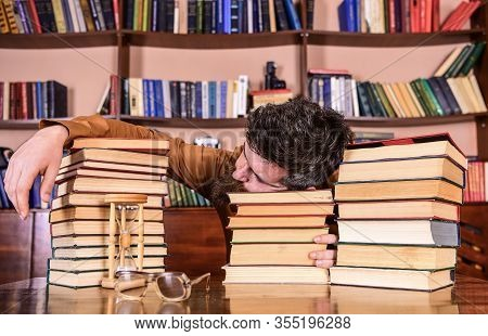 Overstudied Concept. Man On Sleeping Face Lay Between Piles Of Books, Fall Asleep While Studying In