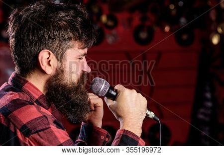 Musician With Beard And Mustache Singing Song In Karaoke. Soloist Concept. Man With Tense Face Holds