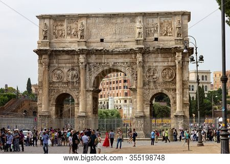 Rome, Italy - June 14 2019: A Straight Portrait Of The Arc Of Constantine Which Is Located At The Co