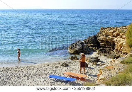 Kato Gouves, Crete, Greece - June 6, 2019 : Tourists On Kato Gouves Beach In Crete The Largest And M