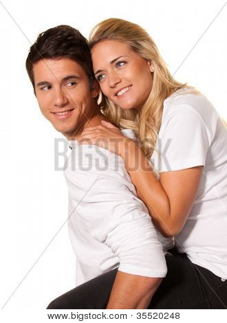 a smiling young couple have fun and joy.