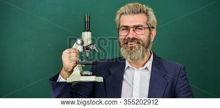 Facilitate Academic Progress. School Teacher Looking Microscope. Scientific Research. Fascinating Re
