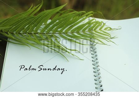 Palm Sunday Concept. With Green Palm Leaf And Text On White Spiral Note Book. Flat Lay Closeup. Happ