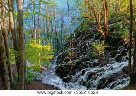 Beautiful View Of Breathtaking Plitvicka Lakes National Park With Water Running Down The Mossy Rocks
