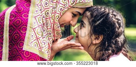 Portrait Of Religious Enjoy Happy Love Asian Family Arabic Muslim Mother And Little Muslim Girls Chi
