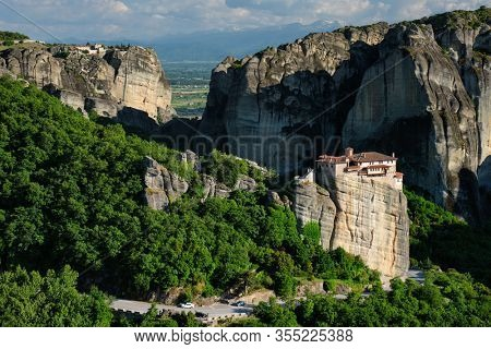 Monastery of Rousanou and Monastery of St. Stephen in famous greek tourist destination Meteora in Greece on sunset with scenic landscape.