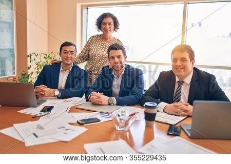 Business lawyers workers meeting at law firm office. Professional executive partners working on finance strategry at the workplace. Smiling happy and cofident to the camera.
