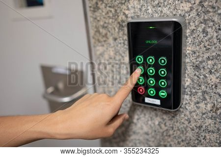 The Security System Pressing Keys On Keypad On The Door At The Bangkok Subway, The Finger Woman At T