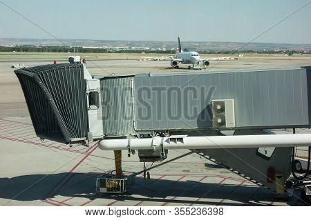 Passenger Boarding Bridge On Airport. Aerobridge, Jetbridge, Jetway.