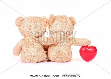 Red Heart And Two Teddy Bears Sit Back On White Background. Love And Relationship Concept. Valentine