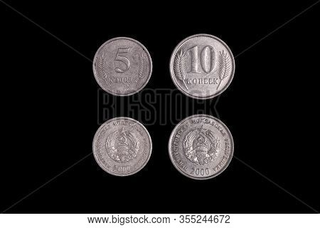 Five And Ten Kopecks, Republica Moldova On A Black Background. Close-up On Two Sides