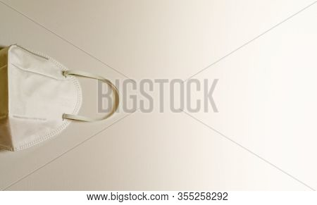 Closeup Of Surgical Medical Particulate Protective White Mask On White Background. Using For Heathca