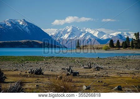 Lake Tekapo With Snow Covered Mountains In The Background, Canterbury, South Island, New Zealand