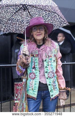 London, Uk- Febryary 15 2020: Fashionable People On The Street . Street Style. Elegant Elderly Woman