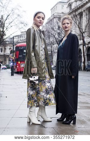 London, Uk- Febryary 15 2020: Fashionable People On The Street . Street Style. Two Girls Friend In L