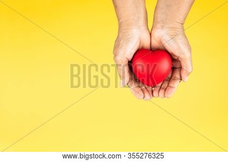 World Health Day Concept Healthcare Medical Insurance With Red Heart On Senior Woman's Hands Support