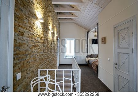 Interior Of A Contemporary Home With Spacious Hallway, Room Doors And Staircase Railing In Modern St
