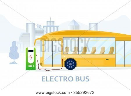 Charging Yellow Electric Bus At The Supercharging Station For Eco City Transportation Means. Electro