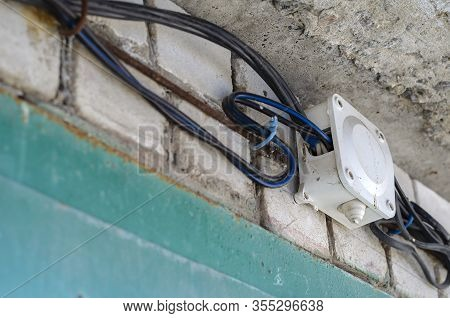 Junction Box For Wiring With Electrical Cables On The Wall. Wires In Black Insulation Are Included I
